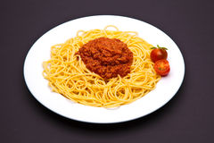 Bolognese pasta dish. On dark background stock photo