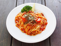 Bolognese pasta. A plate of spaghetti bolognese on wooden table stock images