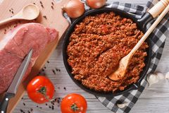 Bolognese sauce cooking in a frying pan horizontal top view Royalty Free Stock Photography