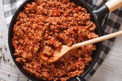 Bolognese sauce in a frying pan close-up horizontal top view stock images