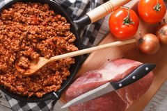 Bolognese sauce and ingredients closeup. horizontal top view Stock Photos