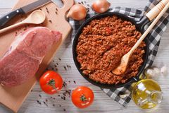 Bolognese sauce in a pan and ingredients horizontal top view Royalty Free Stock Photos