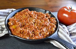 Bolognese sauce with parmesan cheese in a cooking pan or iron pan Royalty Free Stock Images