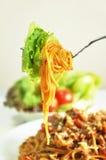 Bolognese Spaghetti. Spaghetti with vegetable on a fork Stock Photos