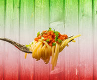 Bolognese Spaghetti, Italian Flag Background. Italian food, Bolognese Spaghetti, italian flag background Royalty Free Stock Photography