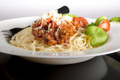 Bolognese spaghetti. Plate of spaghetti bolognese with tomato and chesse in the background stock photos