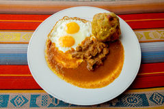 Bolon de verde with fried egg and meat stew Royalty Free Stock Photos