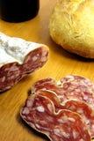 Boloney cortado, pão e vinho Fotografia de Stock Royalty Free