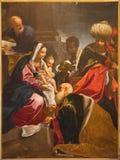Bolonia - adoración de la pintura de unos de los reyes magos de la capilla de la natividad en iglesia del Barroco de San Paolo de  Fotos de archivo libres de regalías
