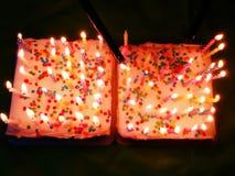 Bolos de aniversário com velas Fotos de Stock Royalty Free