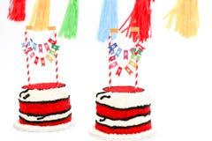 Bolos de aniversário vermelhos gêmeos para a celebração Imagem de Stock Royalty Free