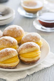 Bolos de Berlim, a Portuguese pastry. Bolos de Berlim are a Portuguese pastry made from balls of fried dough rolled in sugar and stuffed with ovos moles (sweet Royalty Free Stock Images