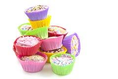 Bolos deliciosos coloridos do copo foto de stock