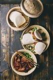Bolos do bao de Gua com carne de porco foto de stock