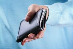 Bolsa com dinheiro à disposição Imagem de Stock