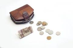 Bolsa com moedas e 100 rublos Foto de Stock Royalty Free