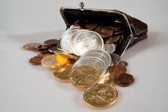 Bolsa completamente de moedas da prata e de ouro Foto de Stock Royalty Free