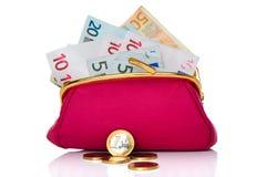 Bolsa completamente do dinheiro isolado no branco Imagem de Stock