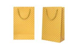 Bolsa de papel amarilla del lunar Foto de archivo