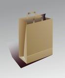 Bolsa de papel beige con las manijas Fotos de archivo libres de regalías