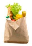 Bolsa de papel con el alimento aislado Fotografía de archivo libre de regalías