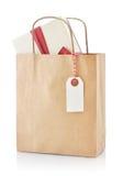 Bolsa de papel con el regalo Foto de archivo libre de regalías