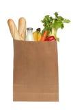 Bolsa de papel con la comida sobre blanco Fotografía de archivo