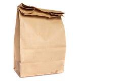 Bolsa de papel de Brown aislada en blanco Fotografía de archivo