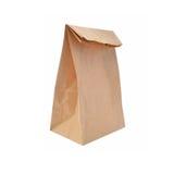 Bolsa de papel de Brown aislada en blanco Fotos de archivo