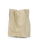 Bolsa de papel de Brown aislada en un fondo blanco Fotografía de archivo