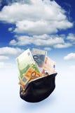 Bolsa preta completamente do dinheiro Fotos de Stock