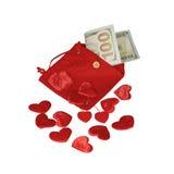 Bolsa roja con cientos dólares de billete de banco Fotos de archivo
