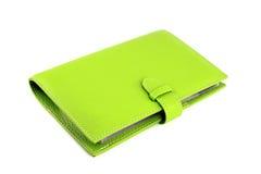 Bolsa verde em um branco fotos de stock royalty free