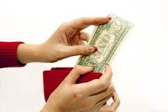 Bolsa vermelha nas mãos com dólar Imagens de Stock