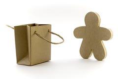 Bolsa y figura de papel Foto de archivo libre de regalías