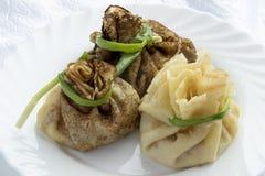 Bolsas de la crepe con el jamón, el queso y salmueras Foto de archivo libre de regalías