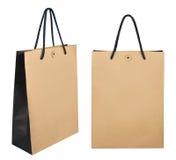 Bolsas de papel de las compras de Brown aisladas en el fondo blanco Imagen de archivo libre de regalías