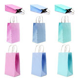 Bolsas de papel de las compras en colores en colores pastel Imagenes de archivo