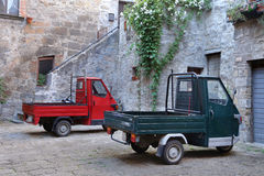 BOLSENA, ITALY - JUNE 28, 2015:picturesque old street with dwell. Ings and an ancient italian vehicle Ape Piaggio in the Bolsena, Lazio Stock Photo