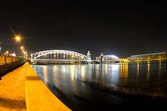 Bolsheokhtinsky Bridge through the Neva River in St. Petersburg in the winter night Royalty Free Stock Image