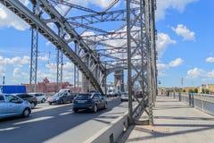 Bolsheokhtinsky bridge. In St. Petersburg. Beautiful bridge in St. Petersburg. The bridge through the river Neva. Design stock image