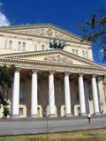 Bolshoi theater in Moscow. A person walks by the Theater. Royalty Free Stock Photography