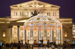 The Bolshoi Theatre on Teatralnaya Square during Christmas time, crowd of tourists go sightseeing. Stock Photo