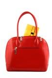 Bolsillo amarillo en un bolso rojo Fotografía de archivo