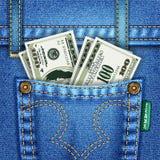 Bolsillo de los pantalones vaqueros con las cuentas de dólar Fotografía de archivo