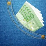 Bolsillo del dril de algodón y 100 billetes de banco euro Imagen de archivo libre de regalías