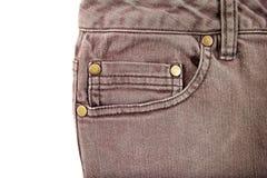 Bolsillo del frente de la mezclilla de Brown con los pernos de cobre amarillo fotos de archivo