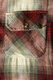 Bolsillo rojo de la camisa de la franela imagen de archivo libre de regalías