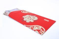 Bolsillo rojo y dinero afortunado en Año Nuevo chino Foto de archivo libre de regalías