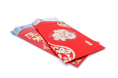 Bolsillo rojo y dinero afortunado en Año Nuevo chino Fotografía de archivo libre de regalías